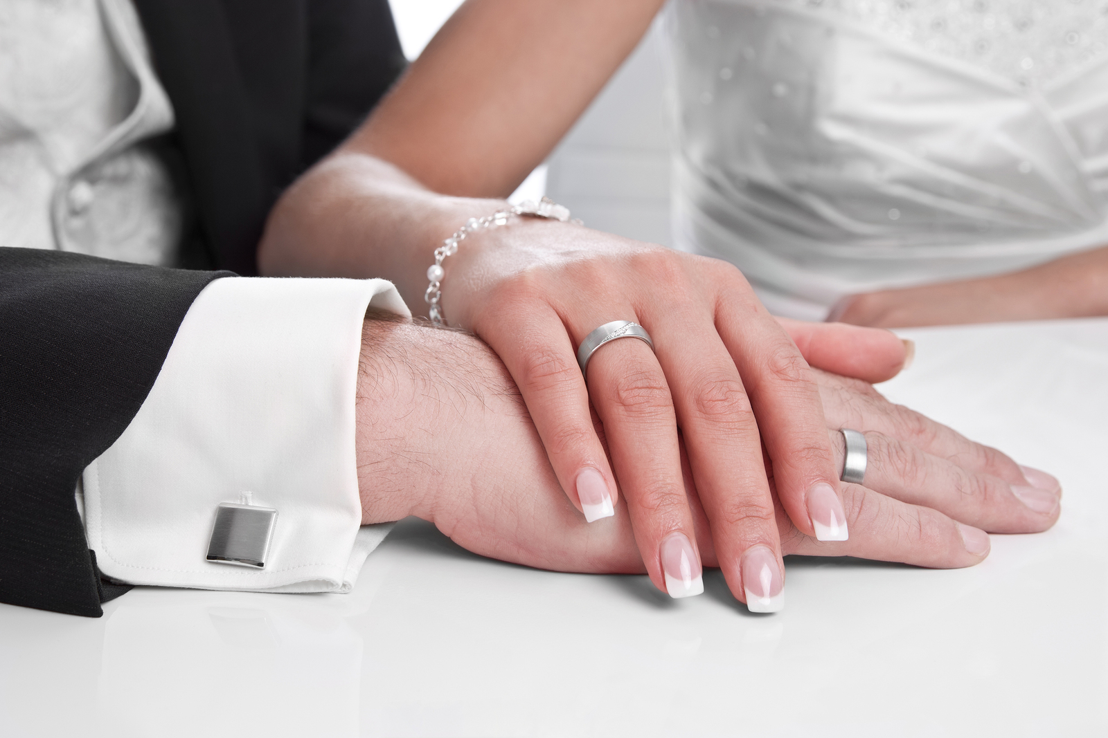 Wedding ring with stone on bride hand - marriage