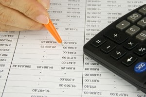 Man hold orange pen is plannng finance account with calculator.